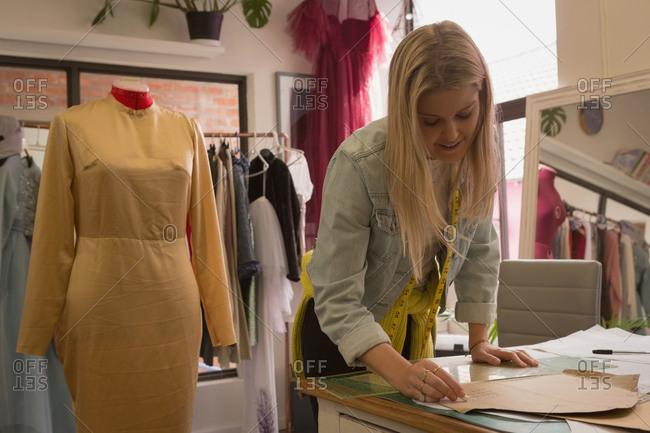 Beautiful fashion designer working in fashion studio