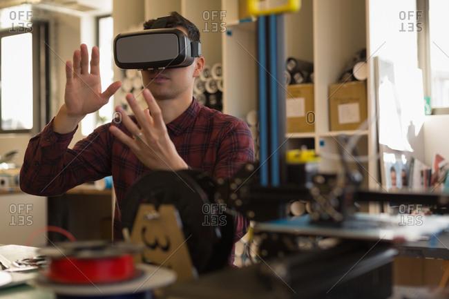 Man using virtual reality headset in workshop