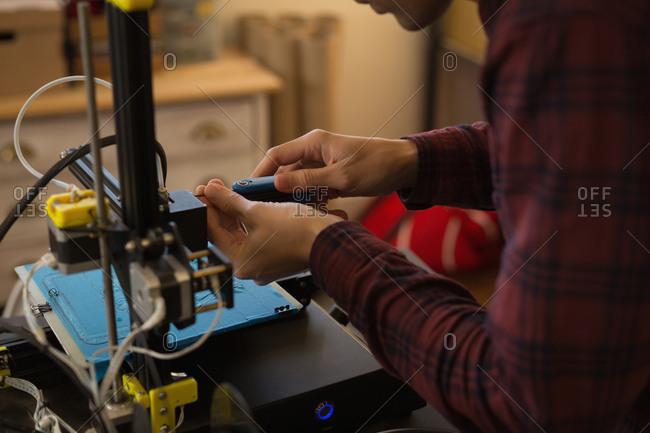 Mid section of mechanic adjusting die machine in workshop