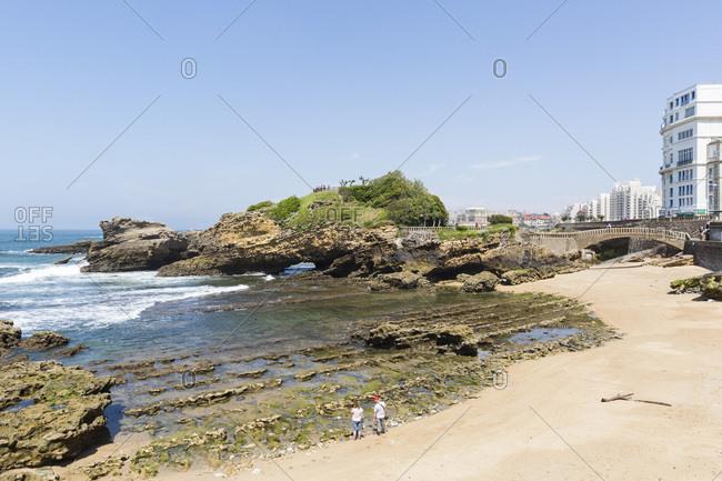 May 22, 2018: Couple on beach near la Basta, la Grande Plage, Biarritz, France