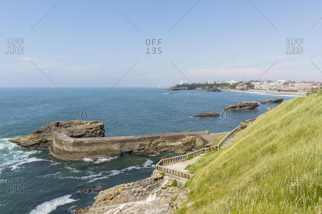 Breakwall and old stairway leading to Pointe Atalaye, Biarritz, France