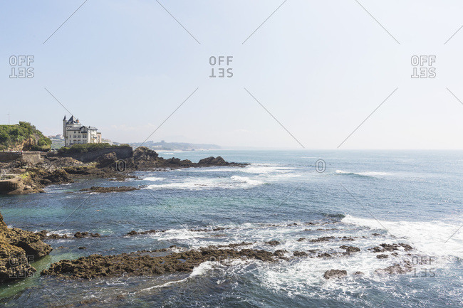 Looking east and beautiful house on the rocky shoreline, Biarritz, France