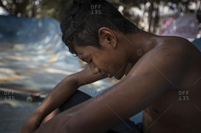 Yangon, Myanmar - April 28, 2016: Boys at a skatepark in Yangon, Myanmar