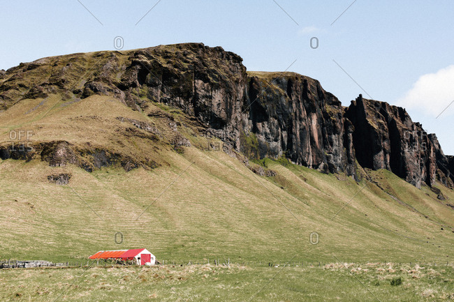 House by a mountain by Rind Road in Iceland