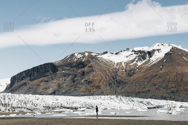Woman hiking by Svinafellsjokull Glacier at Skaftafell National Park