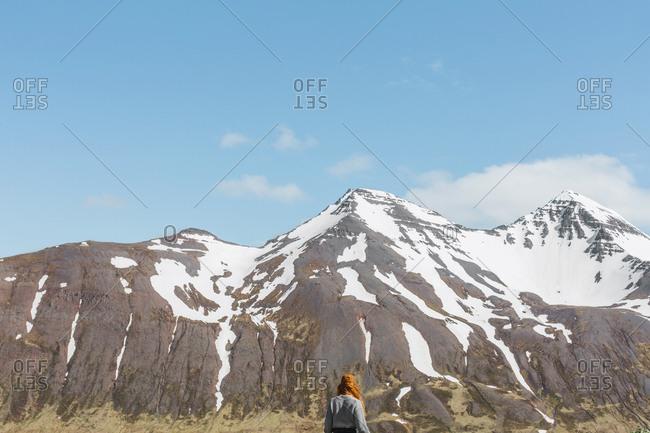 Woman hiking in north fjord near siglufjordur, Iceland