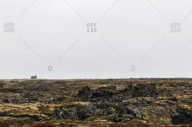 Black church by lava field in Budhir, Iceland
