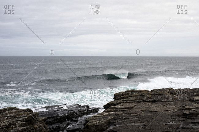 Ocean waves breaking on rocky coast