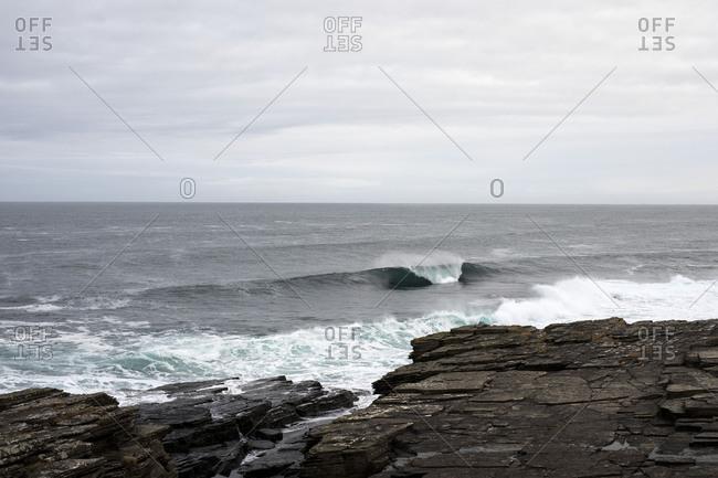 Ocean waves breaking on rocky coast