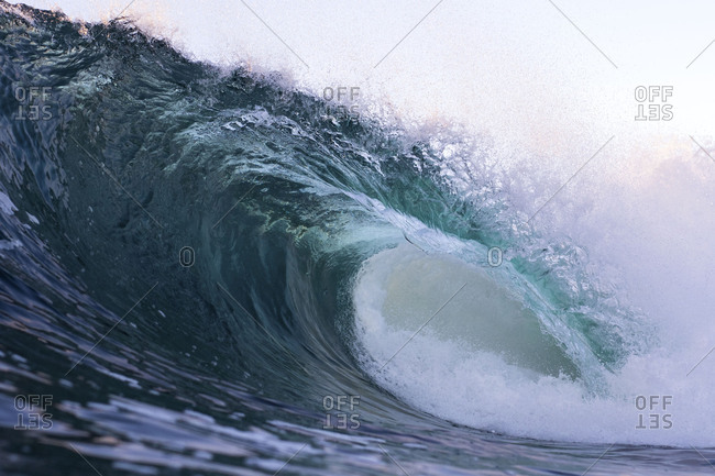 Close-up of large breaking wave in the ocean