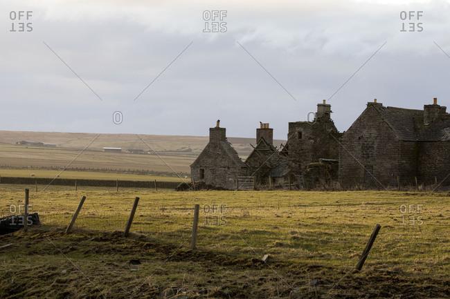 Ruins of historic brick buildings in rural area