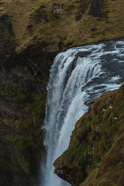 view of huge waterfall in Iceland