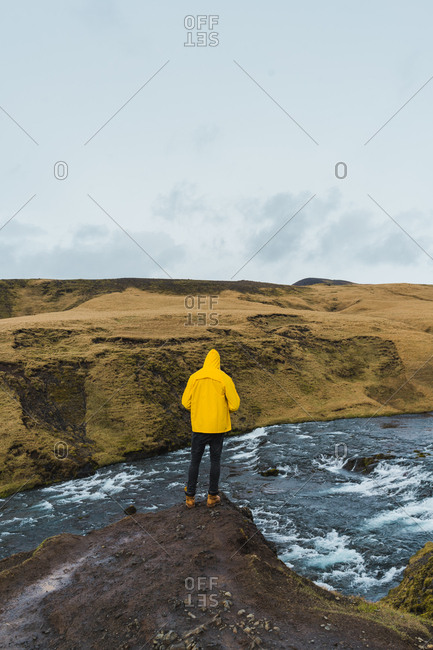 back view of person looking the view and river in Iceland