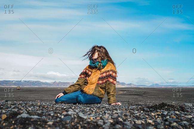 Woman sitting in beautiful nature