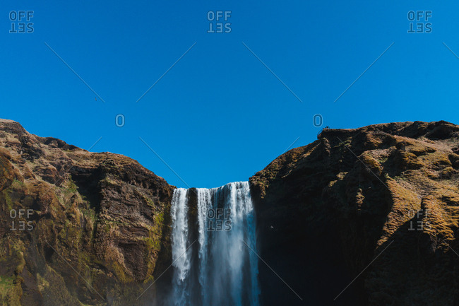 landscape of waterfall from big mountain with blue sky in Iceland