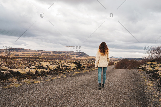 Woman standing on picturesque stony background