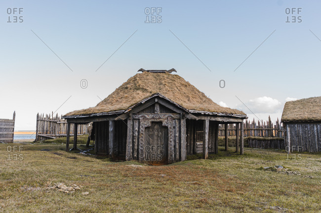 Old triangular wooden Icelandic house with thatched roof