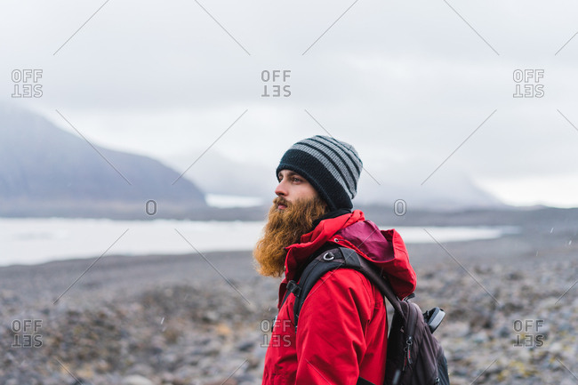 Man in warm clothes in mountains