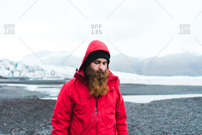 Attractive bearded man in warm clothes in mountains
