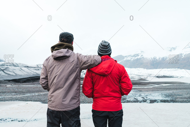 Men in warm clothes standing in mountainous landscape