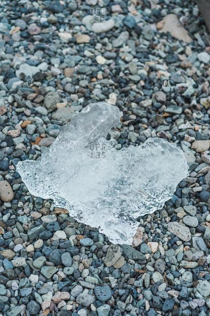 Transparent ice piece on stony background in Skaftafell, Iceland and Vatnajokull