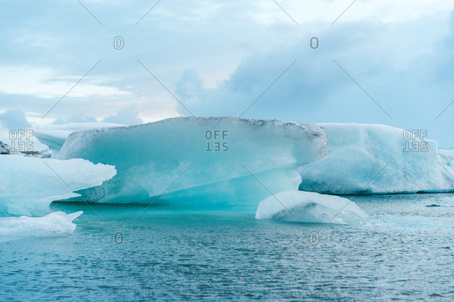 Beautiful view of impressive ice lumps in water in Skaftafell, Iceland and Vatnajokull