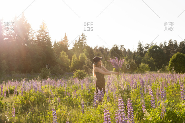 Woman with flowers in bright sunshine