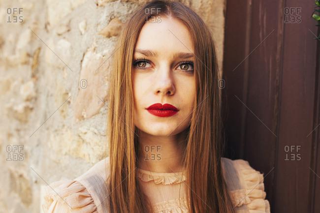 Young beautiful woman posing outside