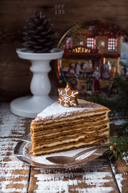 Tasty sweet cake with snowflake decoration on wooden table.