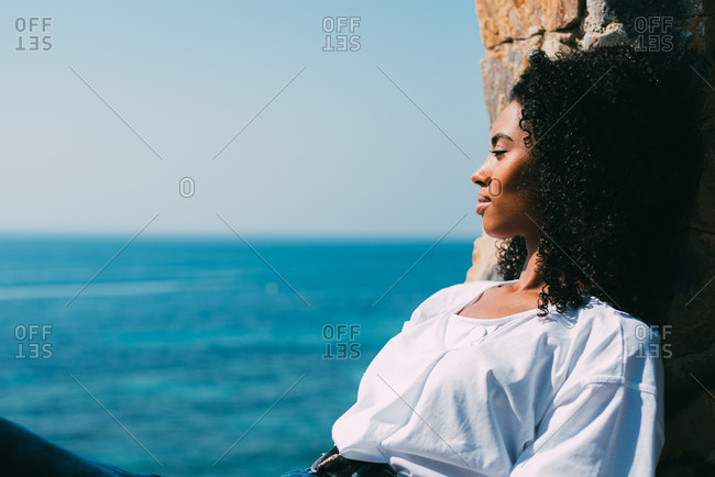 Woman sitting contemplating the sea view