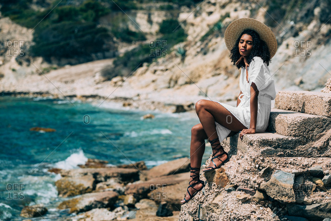 Black woman with straw hat enjoying the views