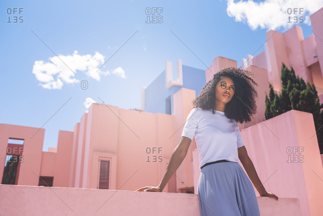 Black woman in a colorful geometric building