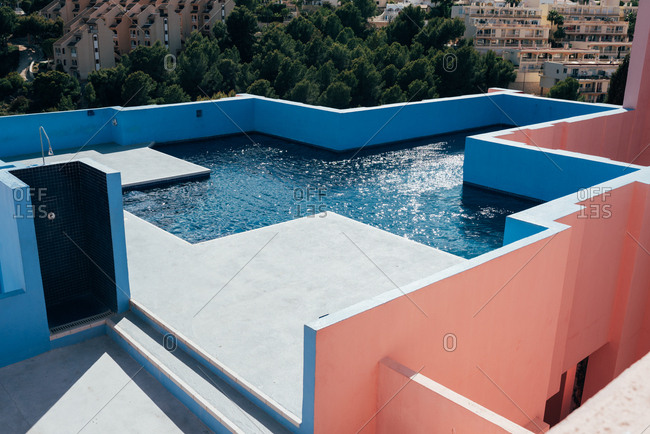 Modern architecture of a blue building swimming pool cross shape