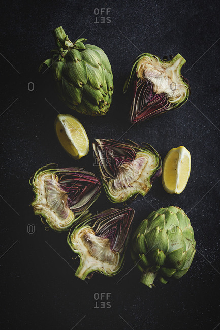 Top view of fresh artichokes over grunge background