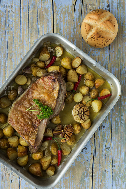 From Above a roast lamb with potatoes and bread