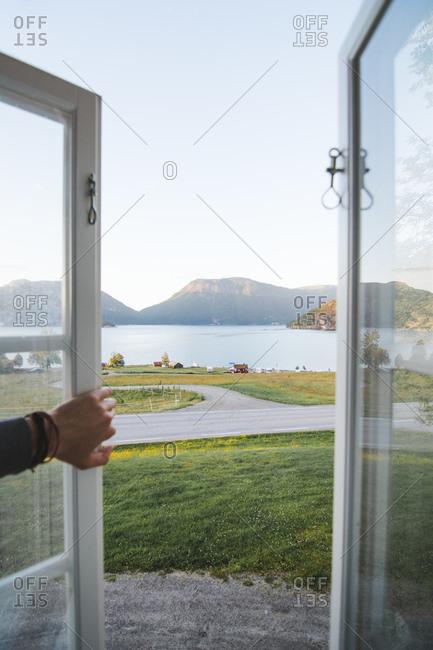 Beautiful lake and mountain landscape view lying through open window
