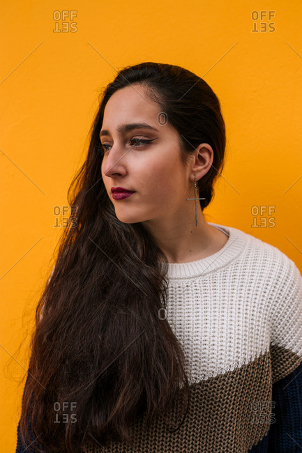 portrait of young teenage girl on the street on a yellow background