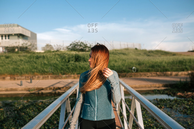 portrait of attractive young woman on a pier