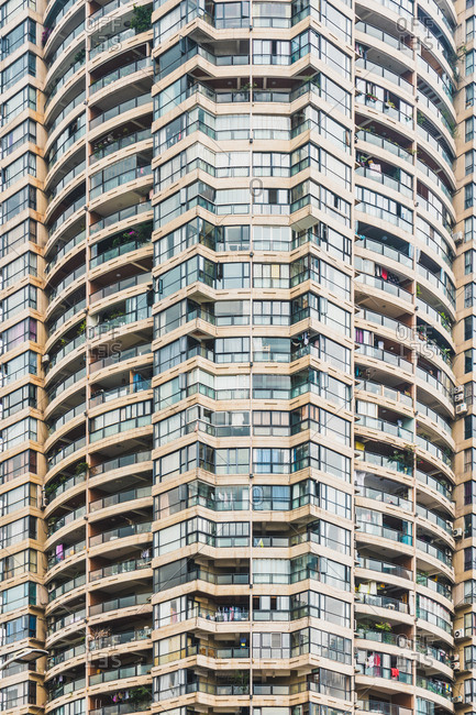 Exterior shot of residential condominium house with endless number of apartments, Chongqing, China