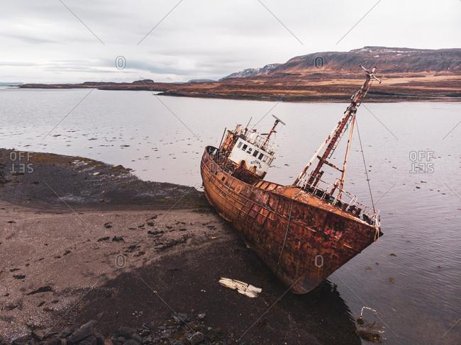 Deserted ship near stony coast