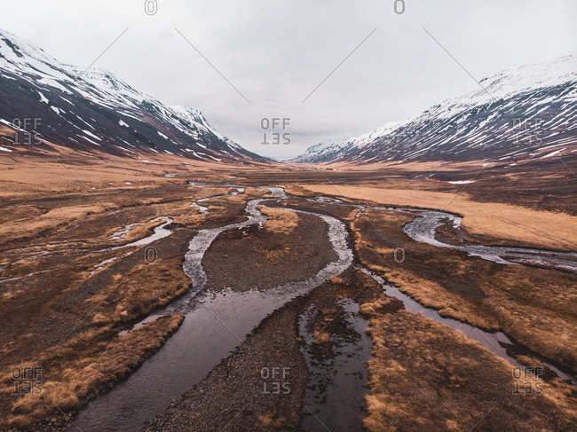 View of empty wetland between short mountains in North Iceland