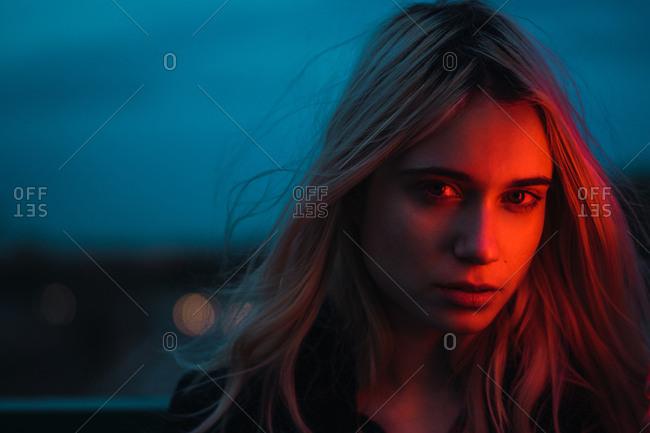 Thoughtful blonde woman in dusk