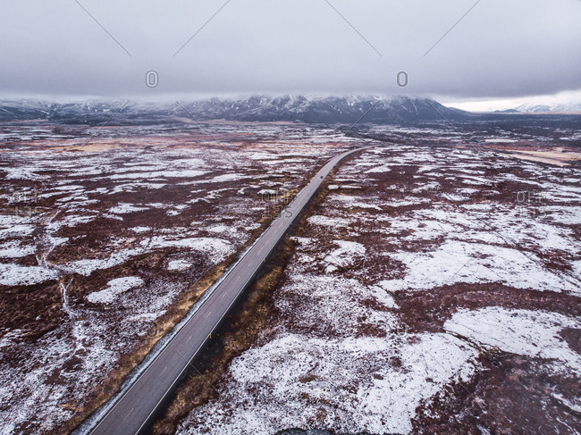 Road through snowy open space in Iceland