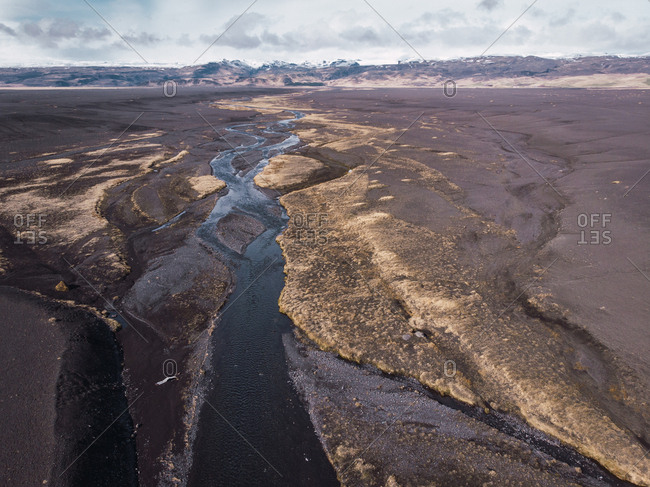 View from above of Iceland panorama with small river and mountains