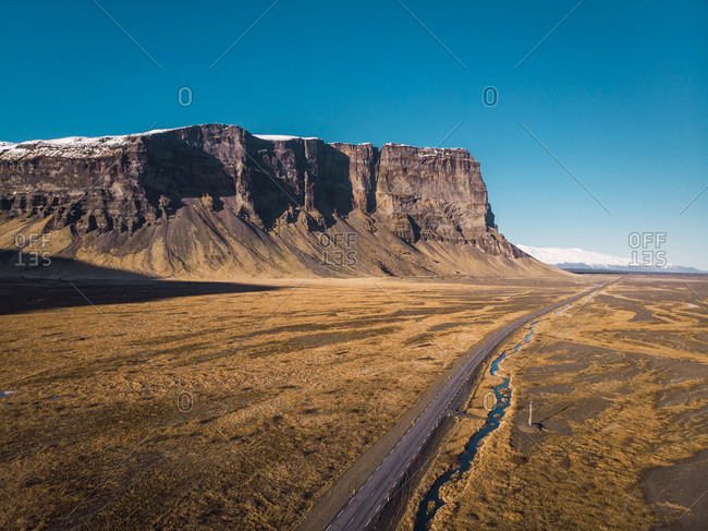 Empty road through wide open space in Iceland