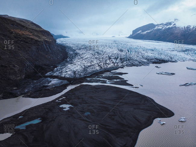 Snowy mountain valley with river in Iceland
