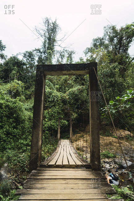 Old grungy wooden bridge in woods
