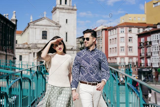 Stylish couple walking on street