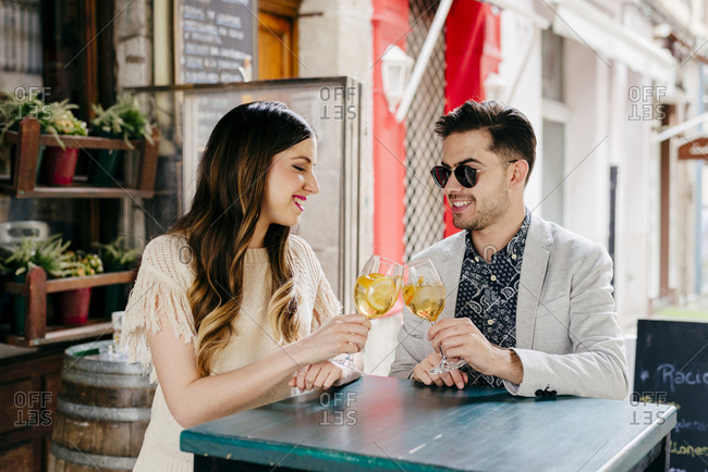 Couple with drinks in outside cafe