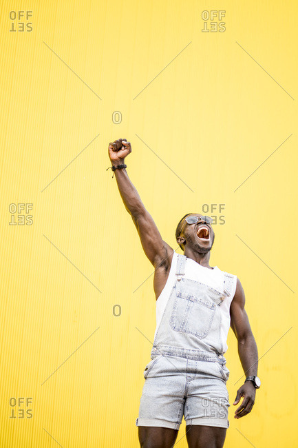 African man shouting victory clenched fist.